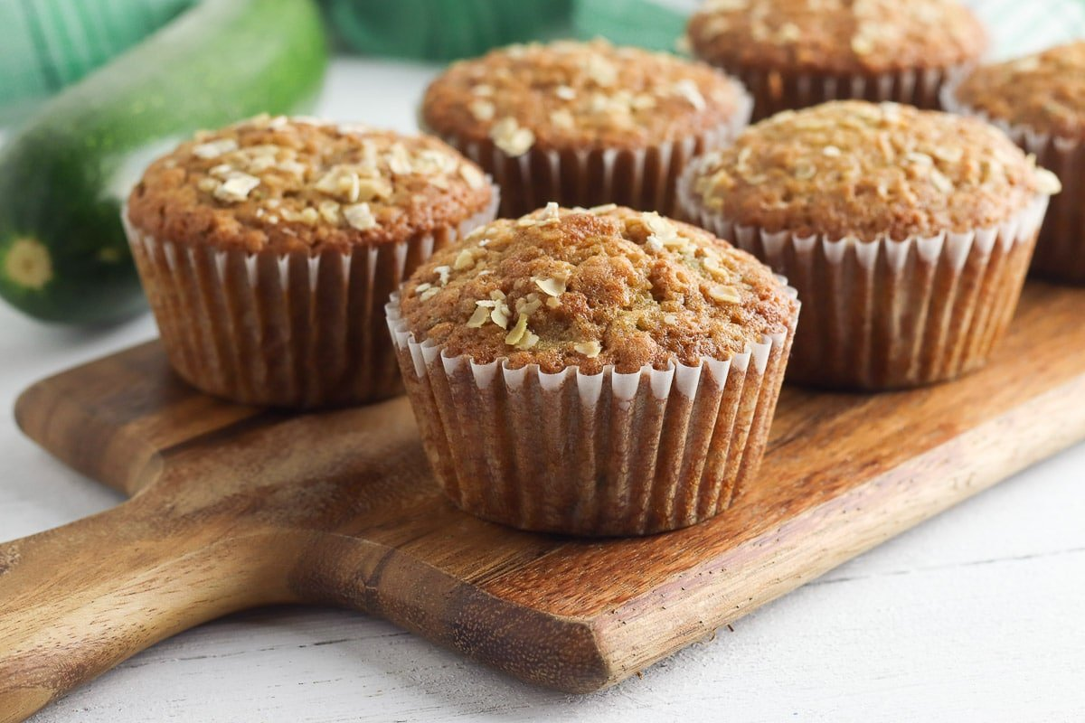 zucchini muffins on handled cutting board - horizontal