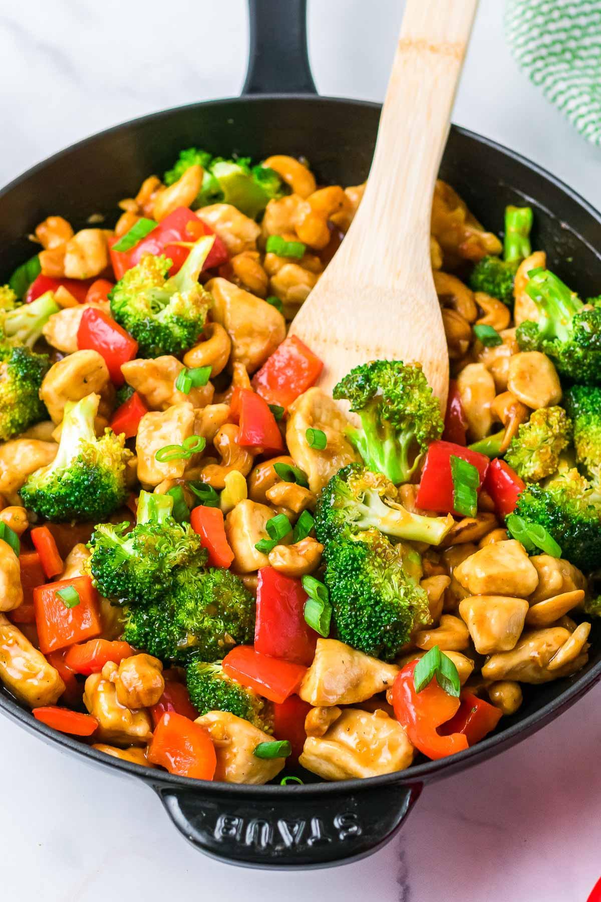 cashew chicken in skillet cooking