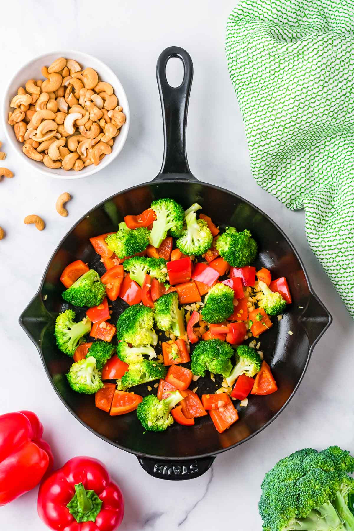 red bell pepper and broccoli in a skillet