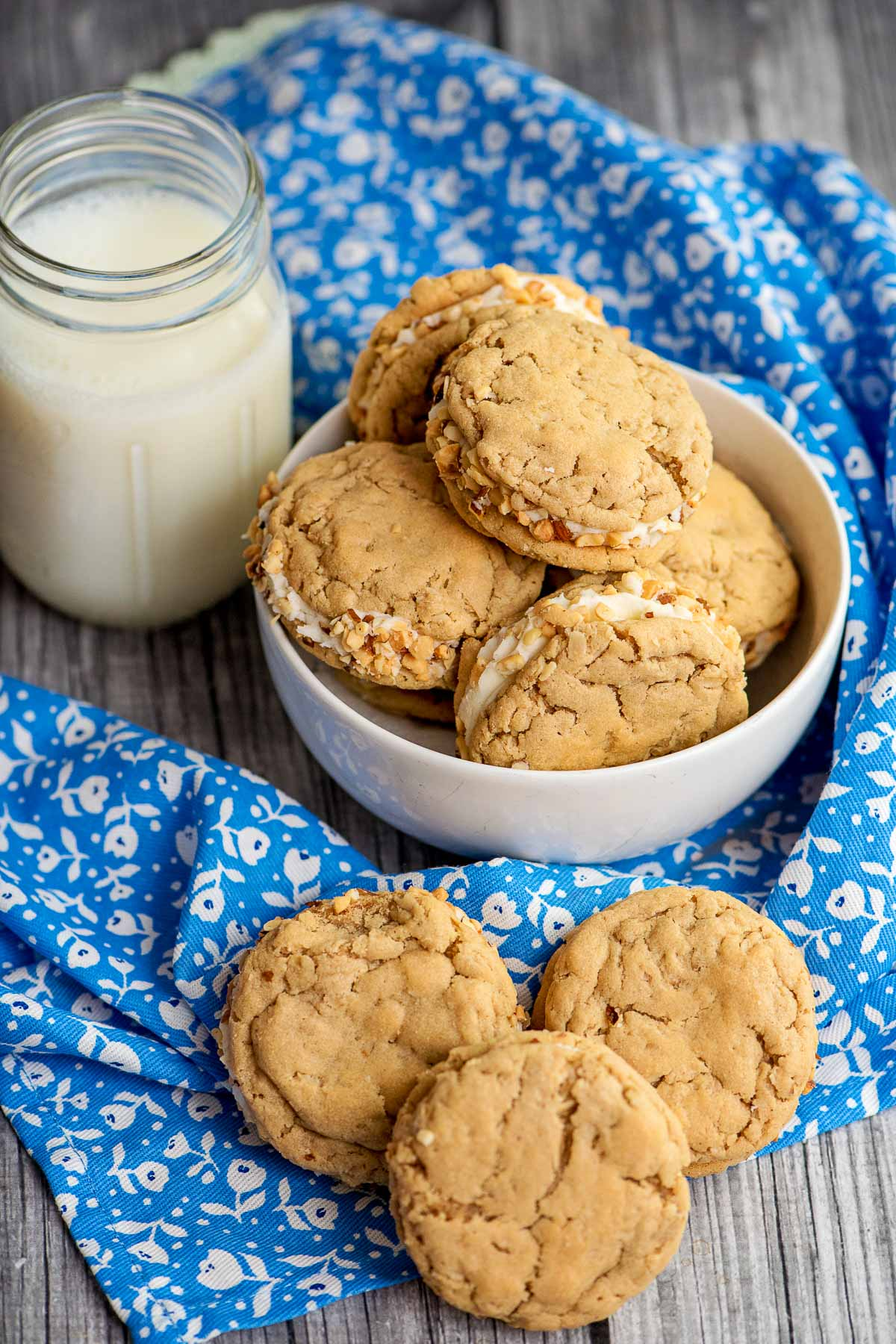 homemade sandwich cookies with a jar of milk