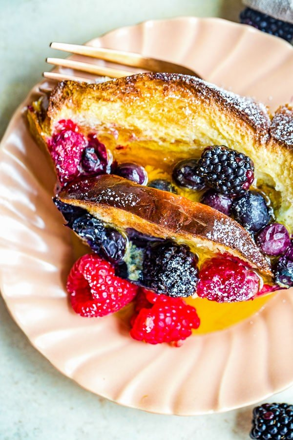 French Toast made with challah bread and fresh berries