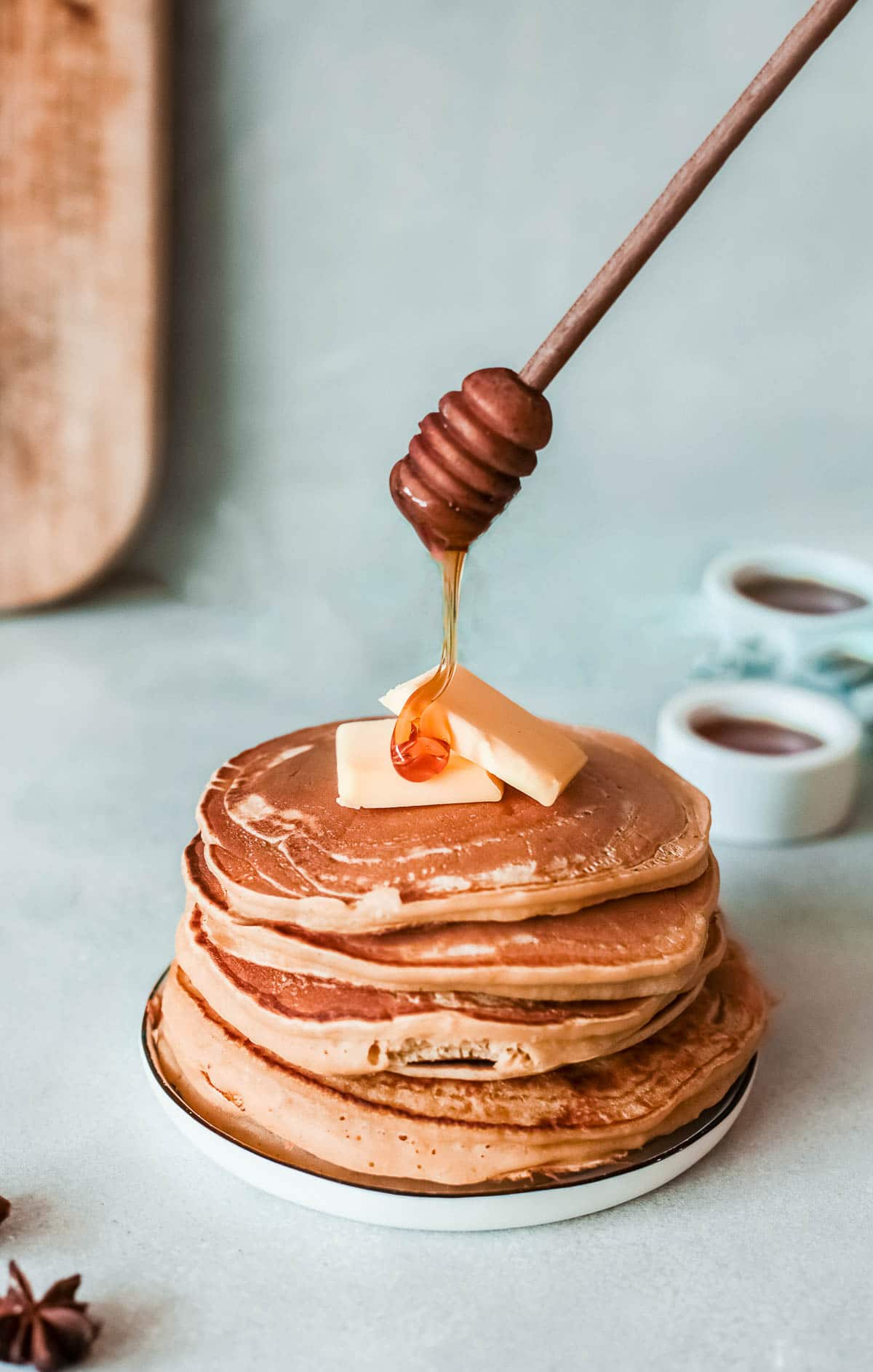 stack of apple pancakes with butter and honey