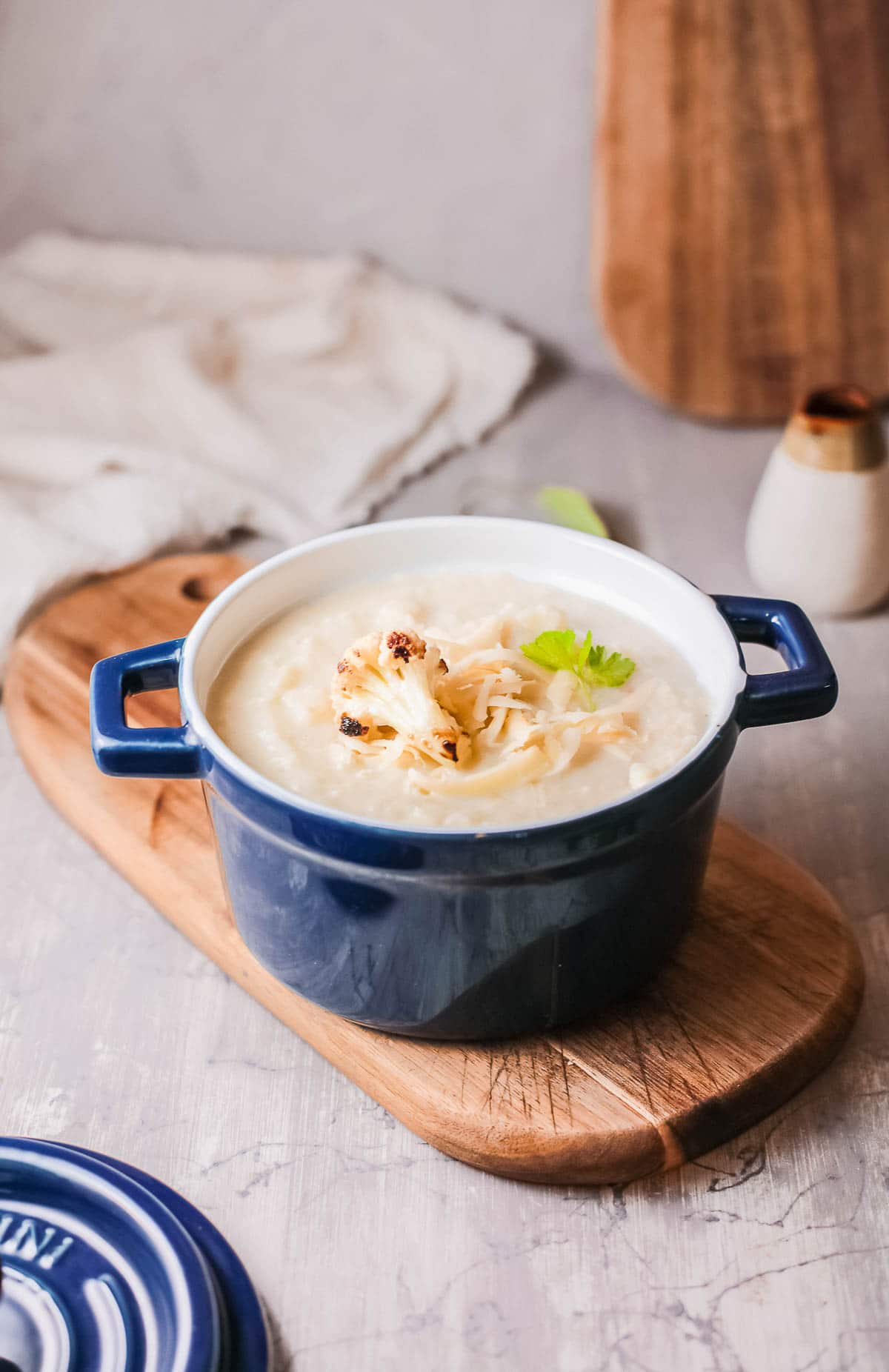 Cauliflower Cheese soup in bowl side view