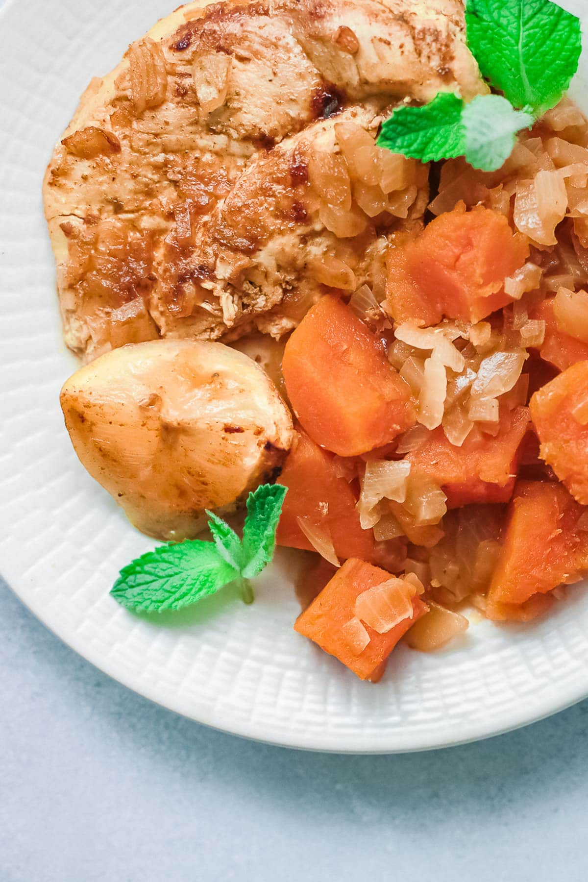 Moroccan Chicken with sweet potatoes close up