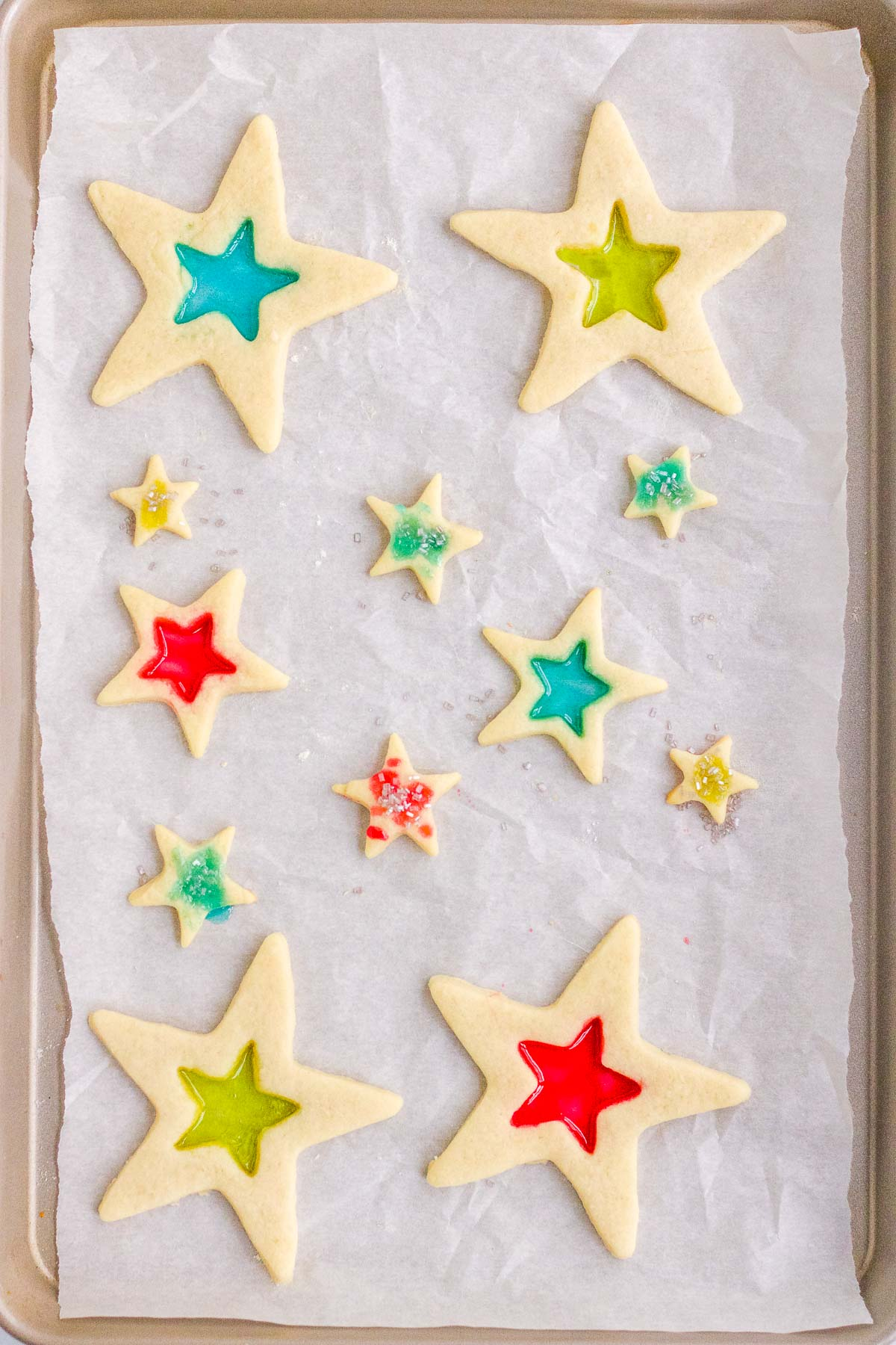 stained glass cookies on a baking sheet