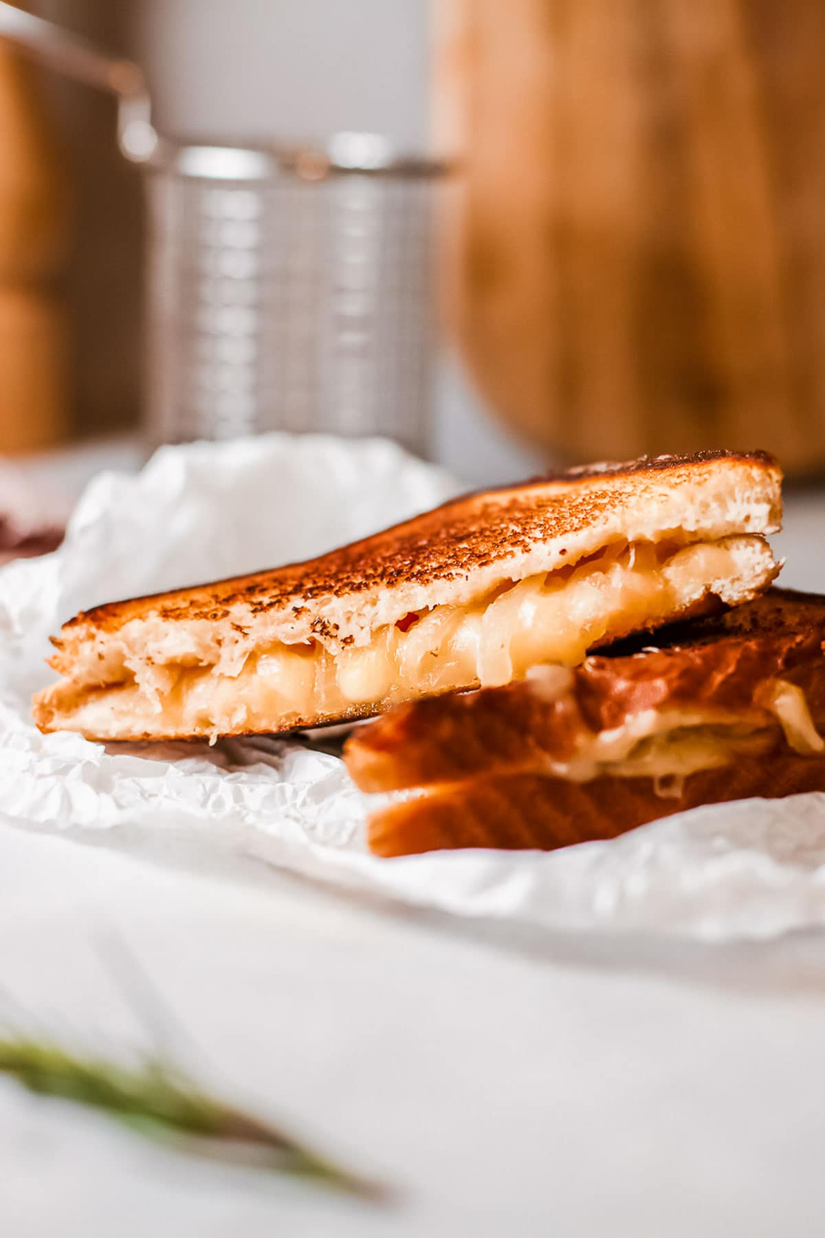 French onion grilled cheese sandwiches halves close up