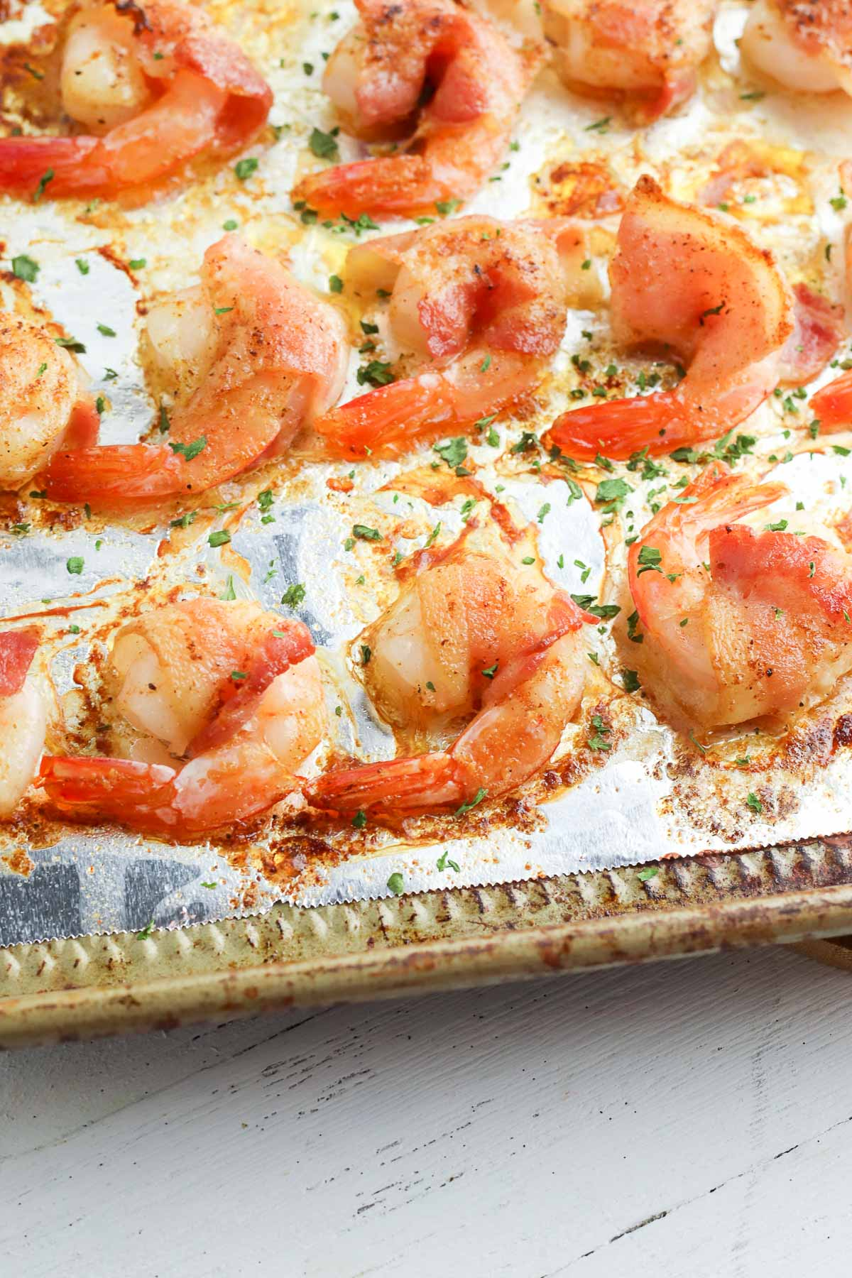 bacon wrapped shrimp on pan