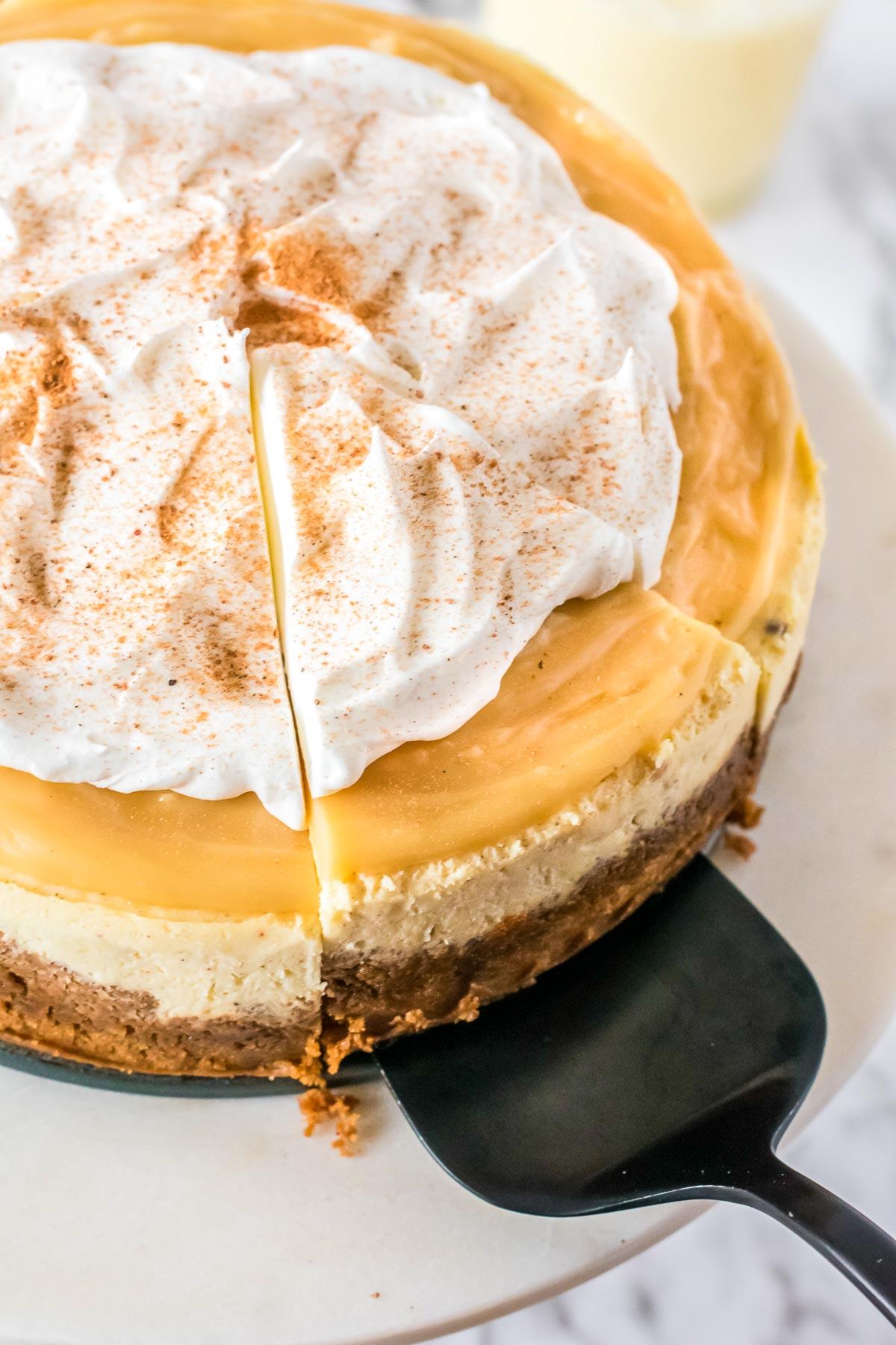 eggnog cheesecake slice on cake server