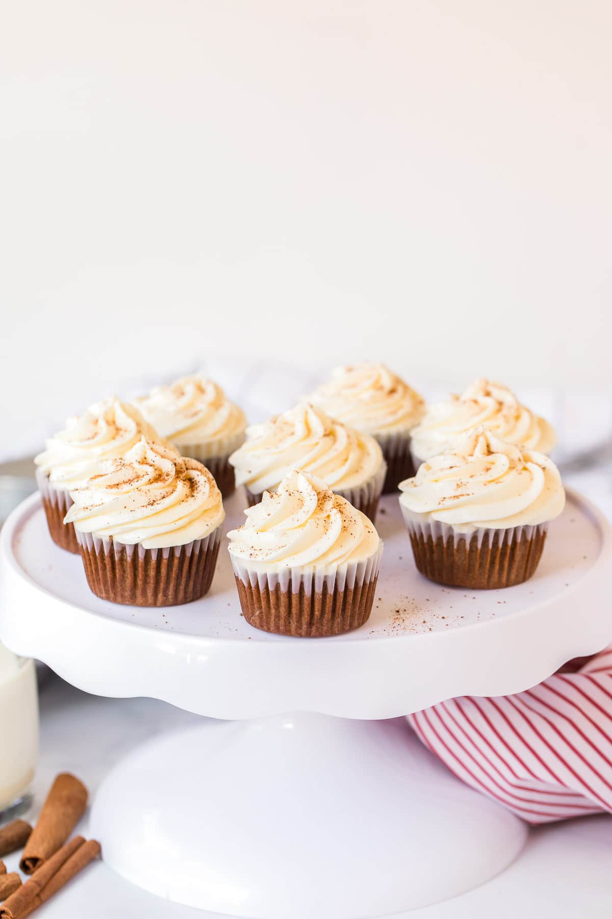 gingerbread cupcakes with eggnog frosting on cake pedestal