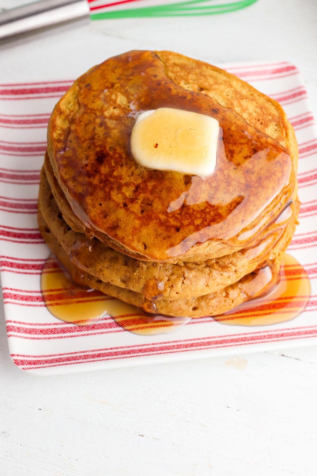 stack of gingerbread pancakes with butter