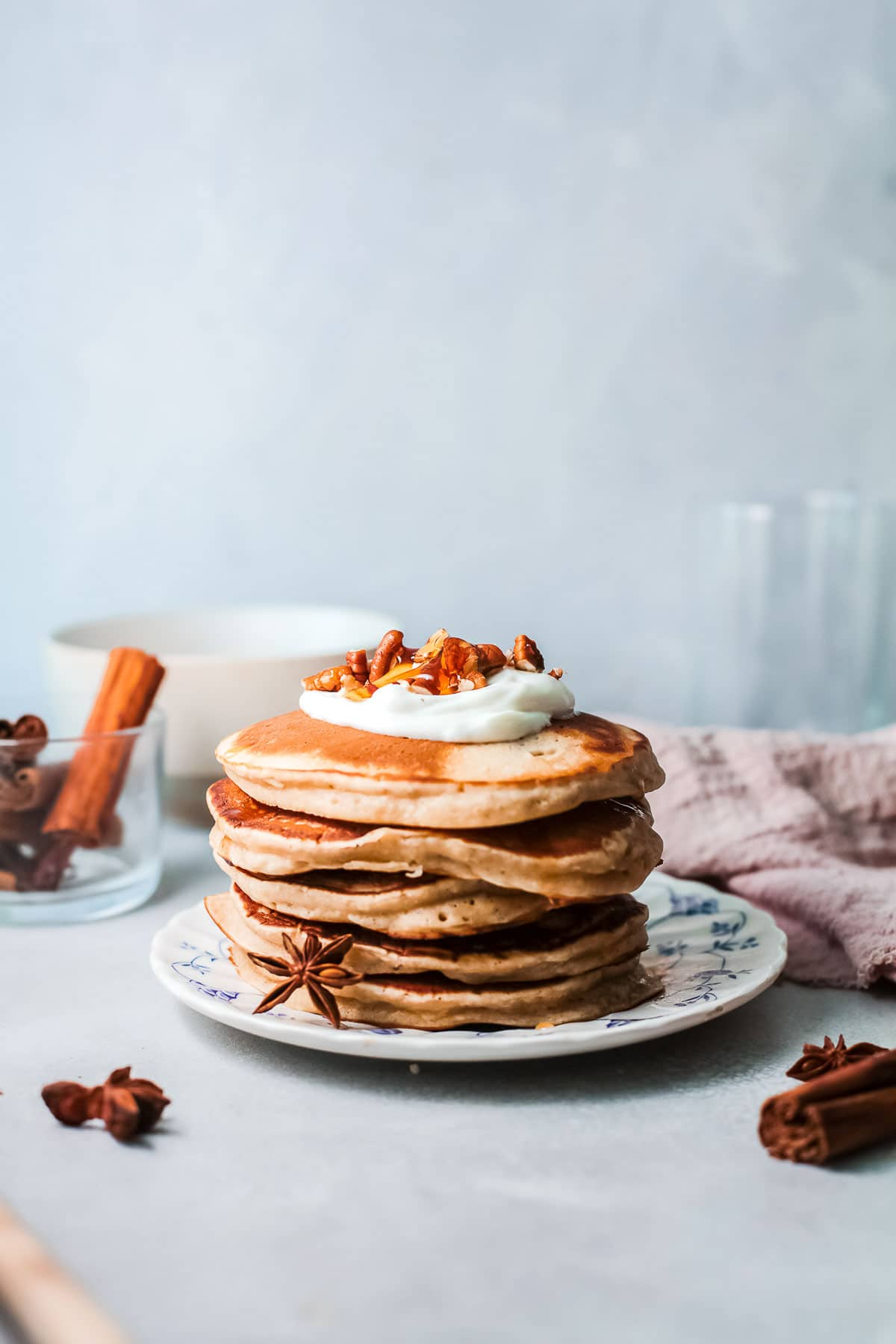 cinnamon pancakes stack with nuts on top