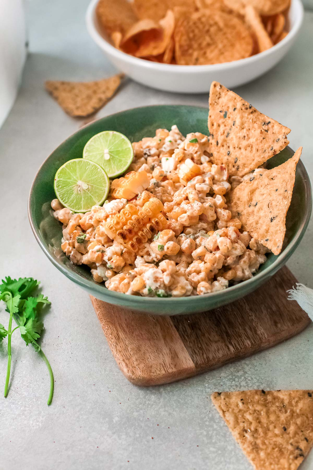 mexican corn dip in a bowl with chips