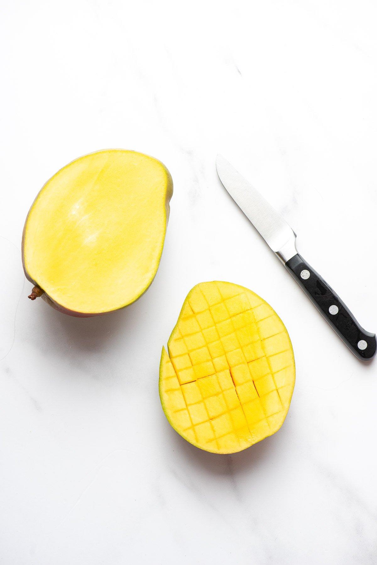 cut side of mango with scored fruit