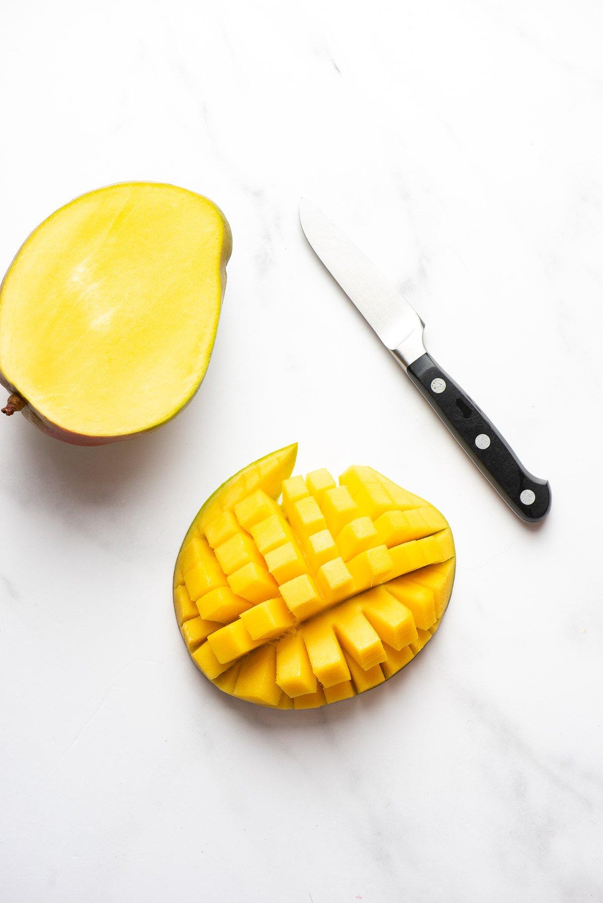 cut mango pieces on skin