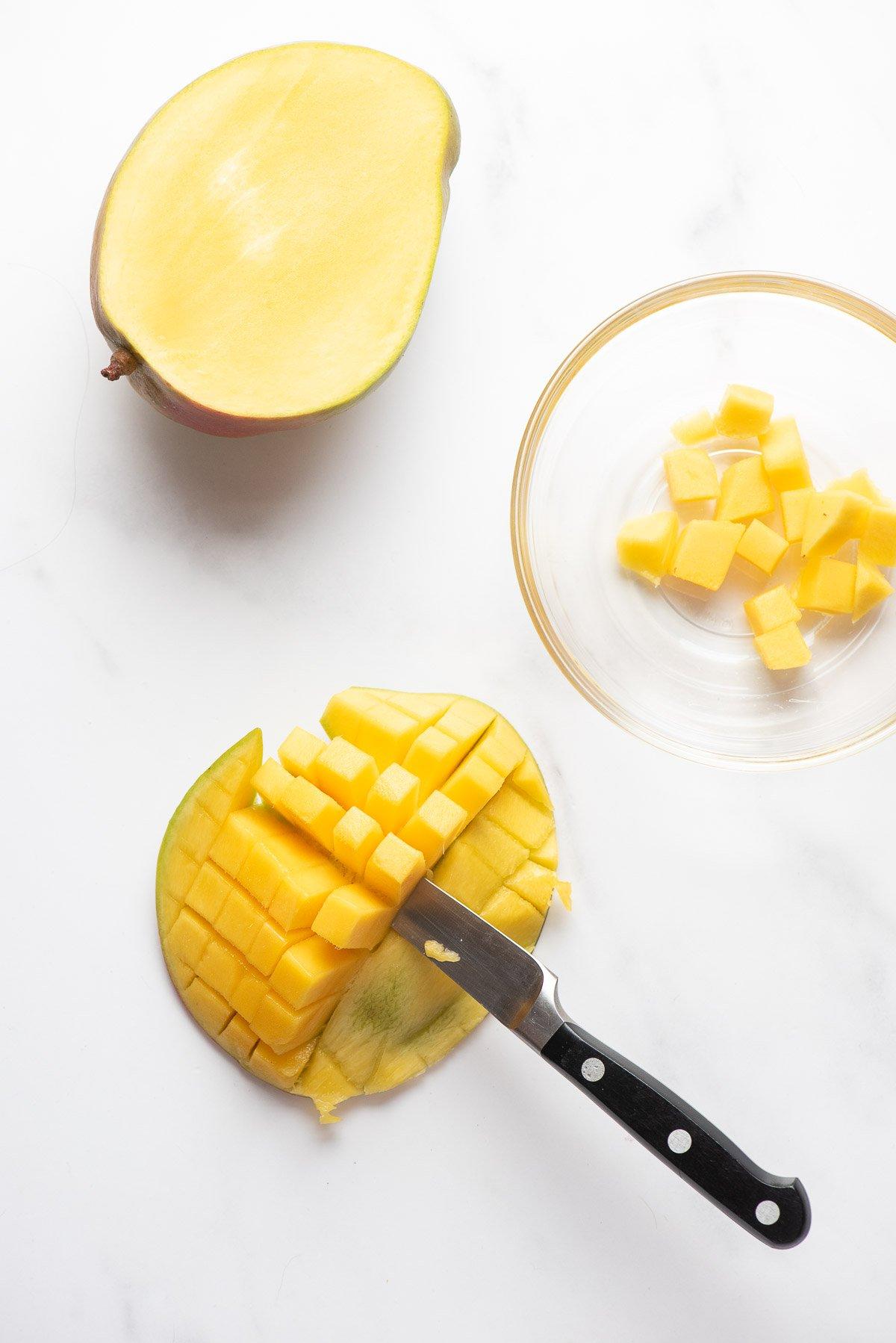 cutting mango fruit from the skin