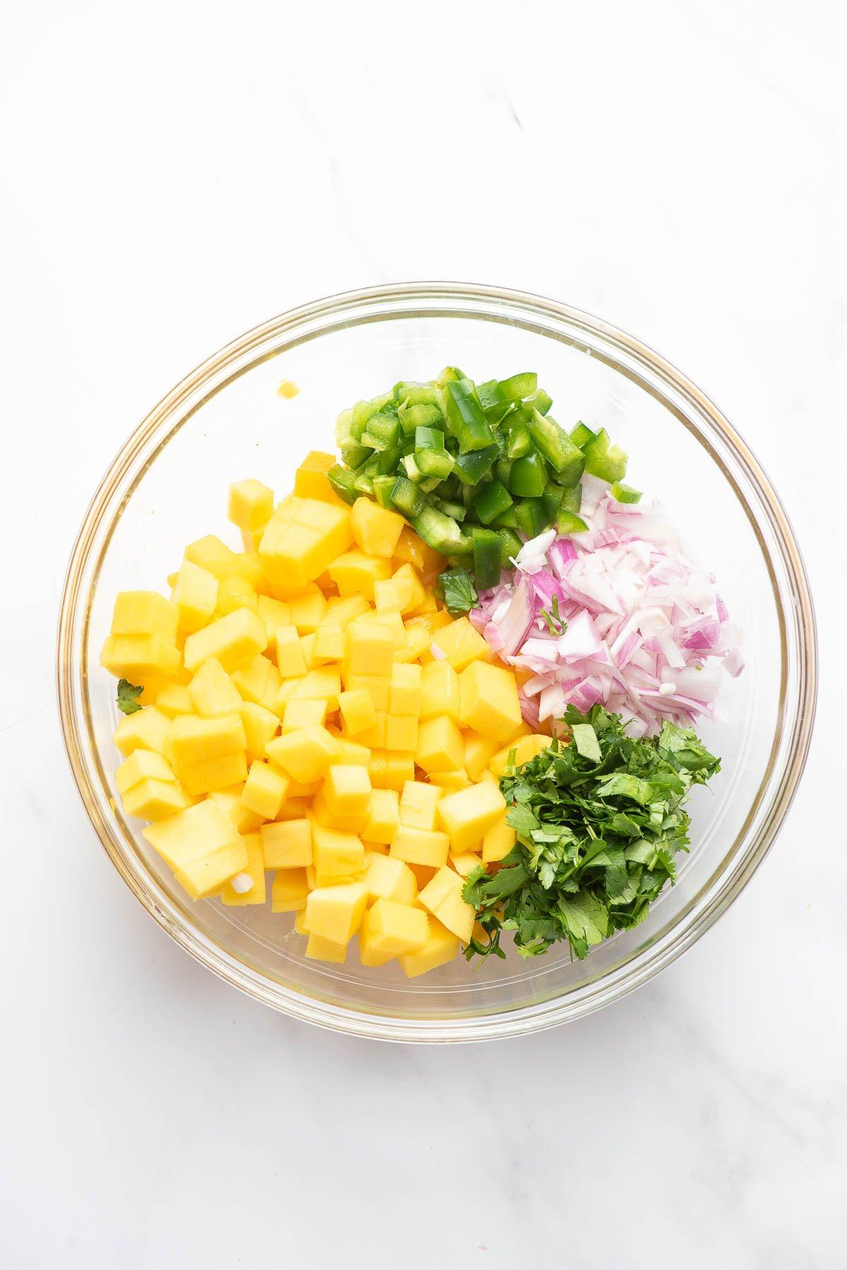 mango salsa ingredients in bowl