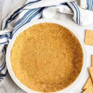 graham cracker pie crust in white pie pan