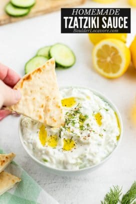 Tzatziki Sauce with a pita wedge being dipped title image