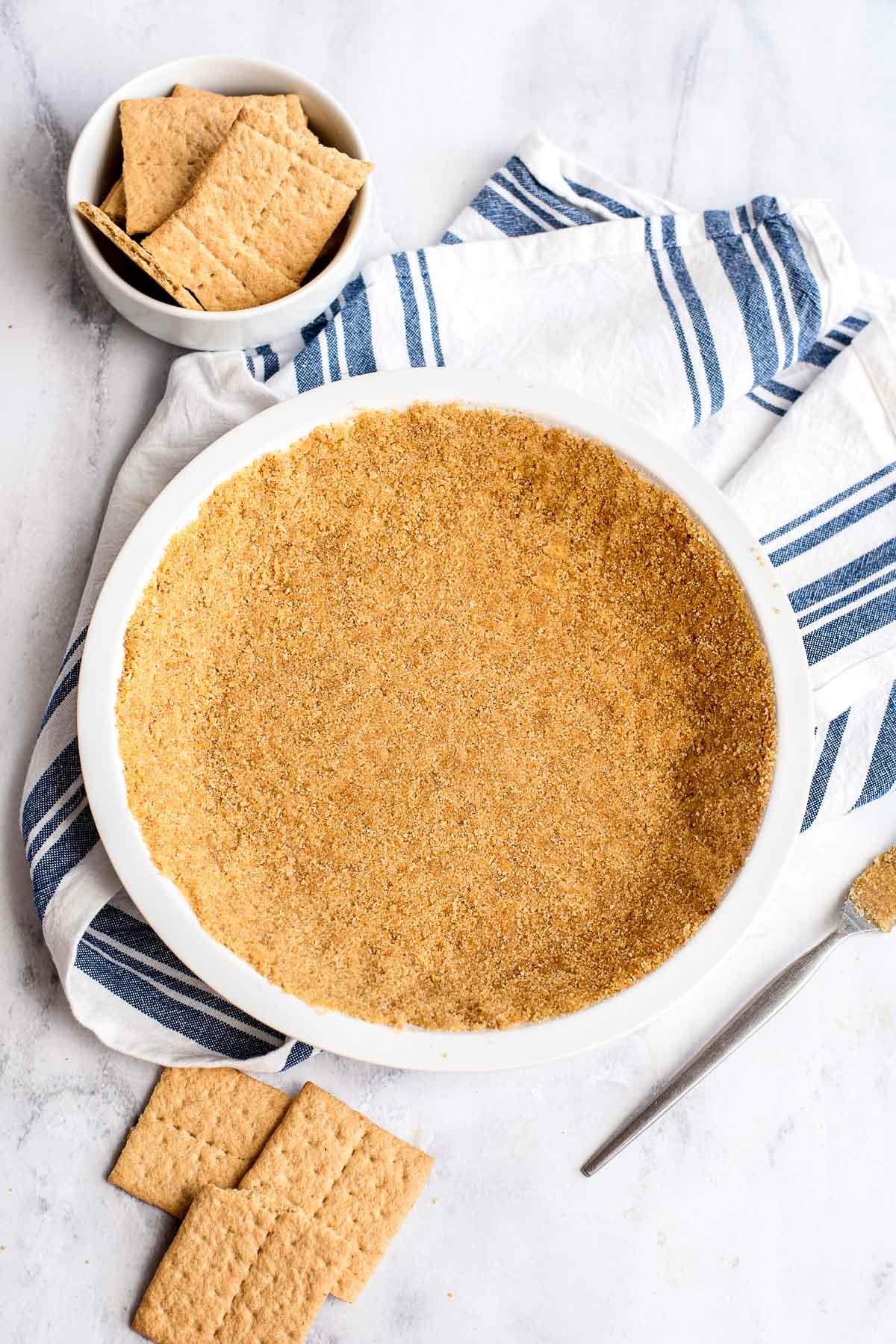 homemade graham cracker pie crust in white pie plate