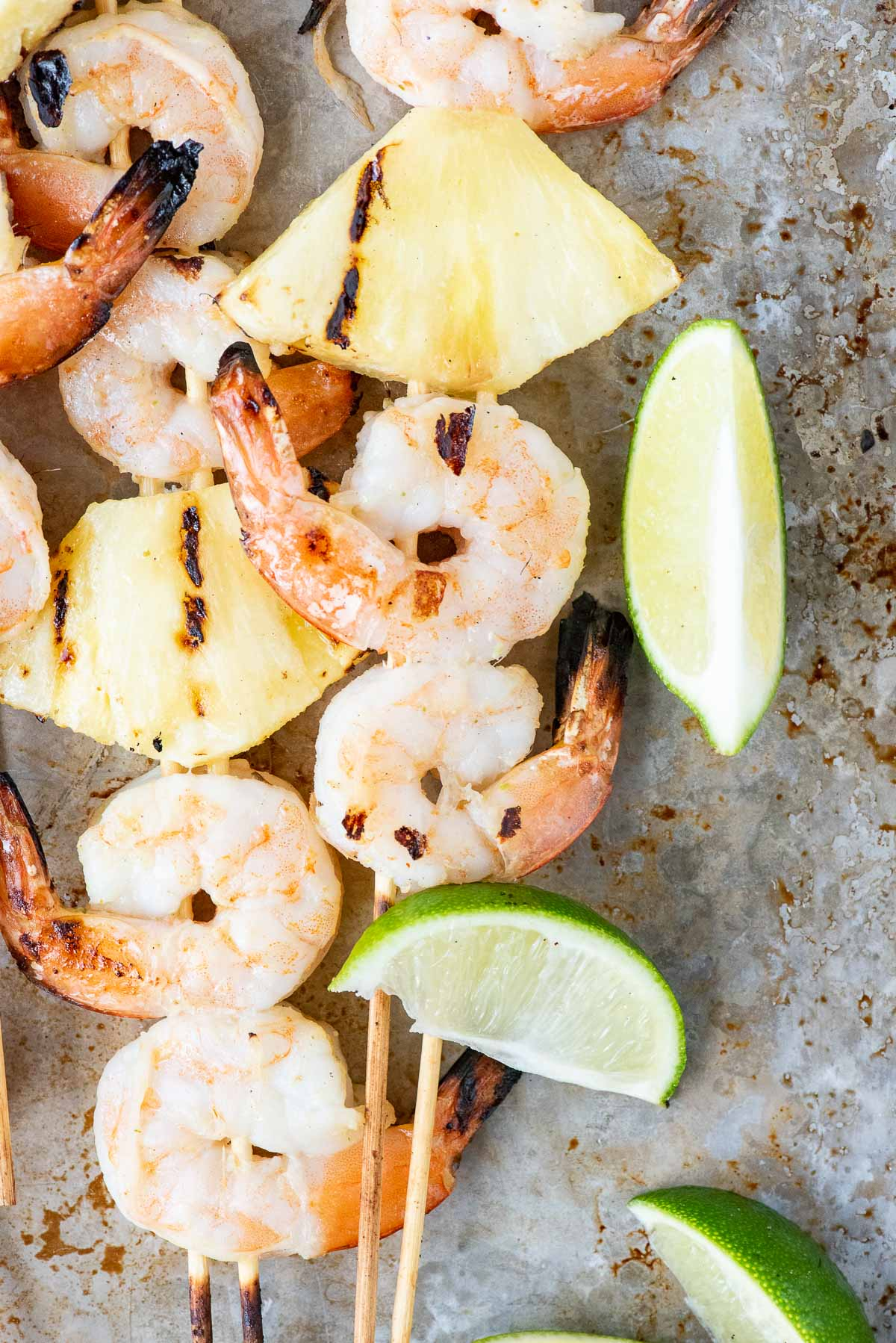 close up of shrimp and pineapple skewers