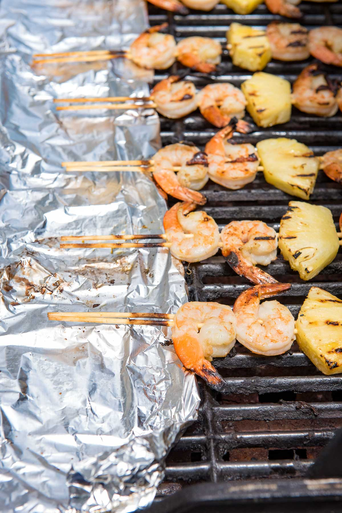 grill with shrimp skewers on grill