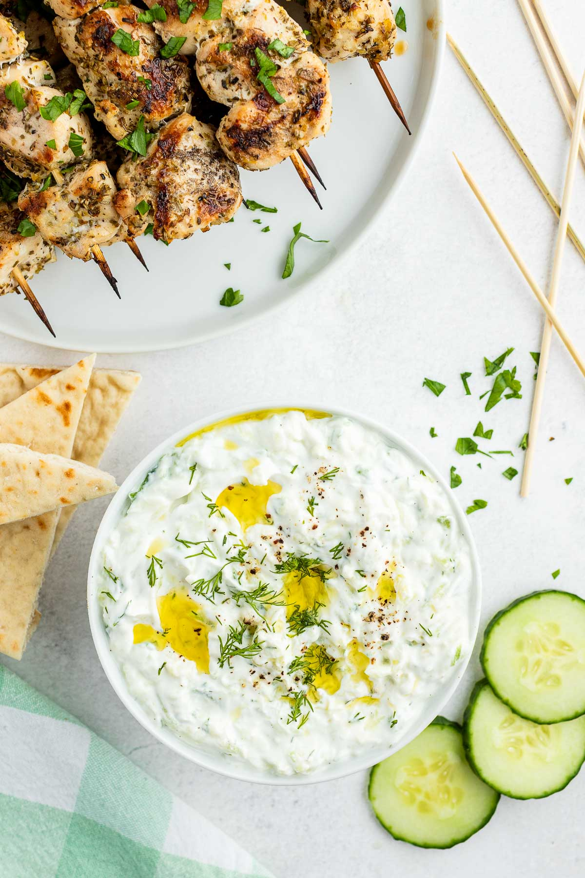 tzatziki sauce with souvlaki skewers from overhead