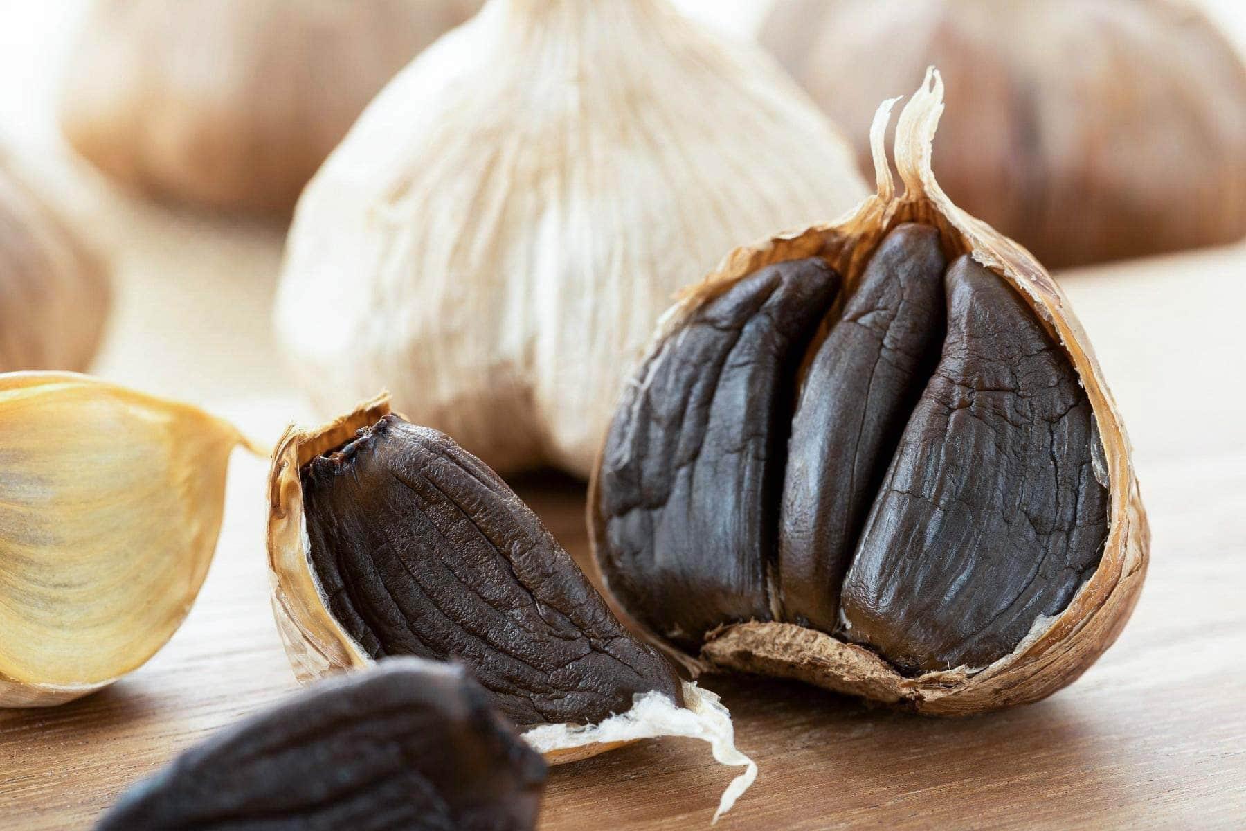 close up black garlic cloves