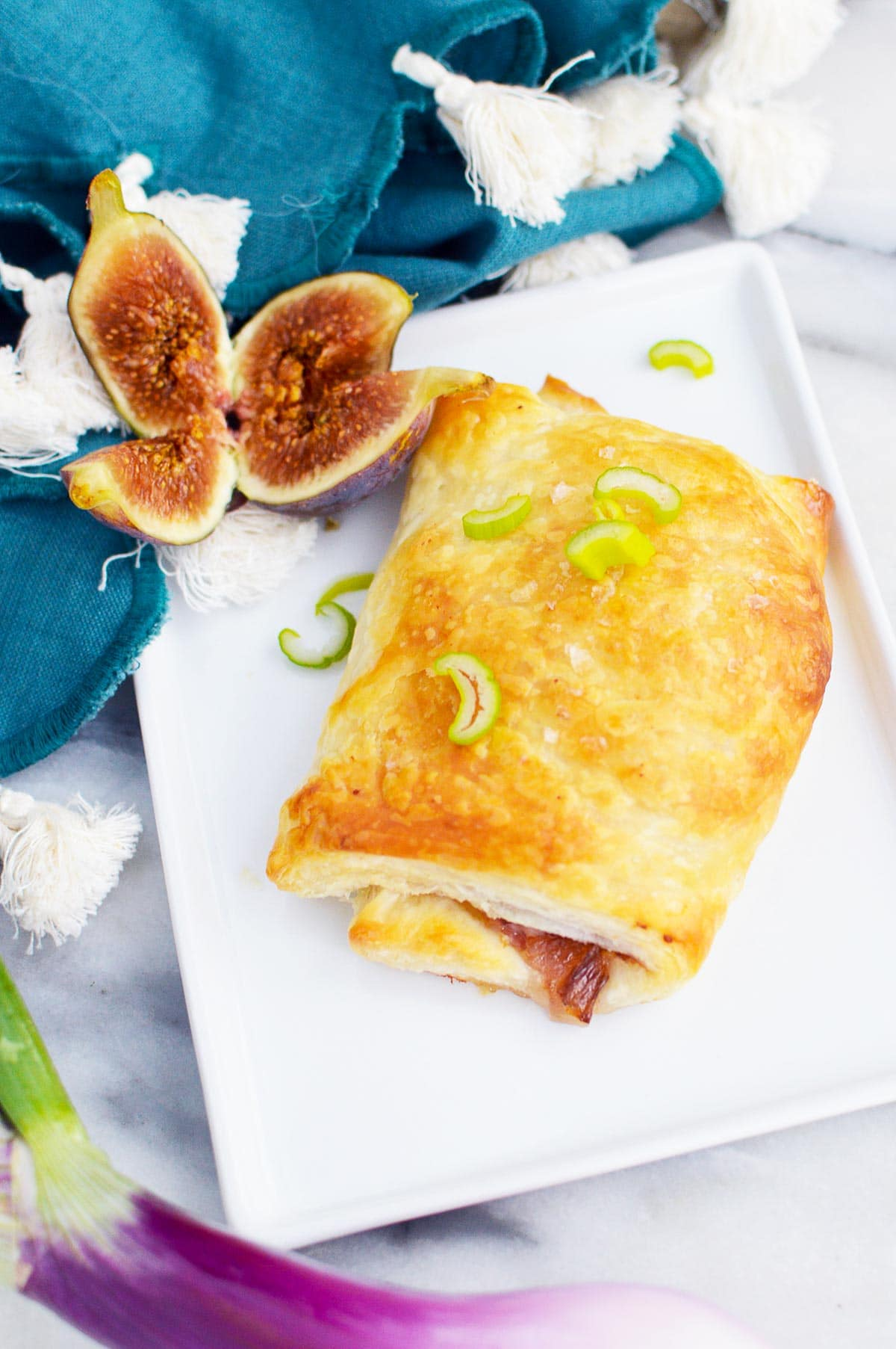 onion and fig puff pastry with figs on plate