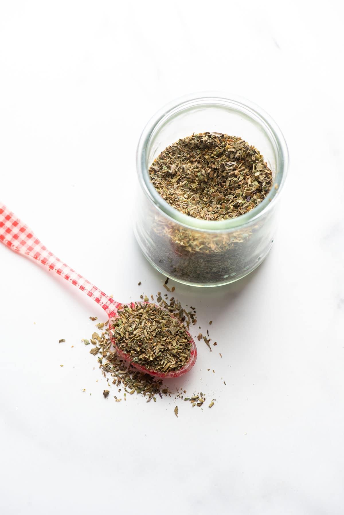 Italian seasoning in jar and on spoon