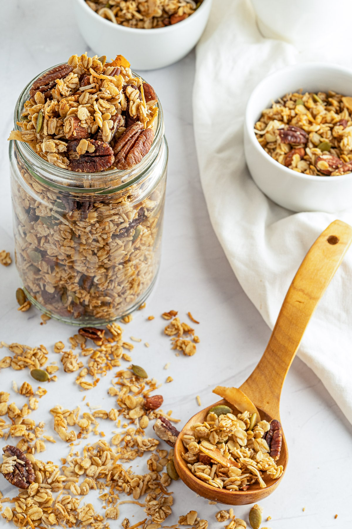 homemade granola jar overhead WITH SPOON