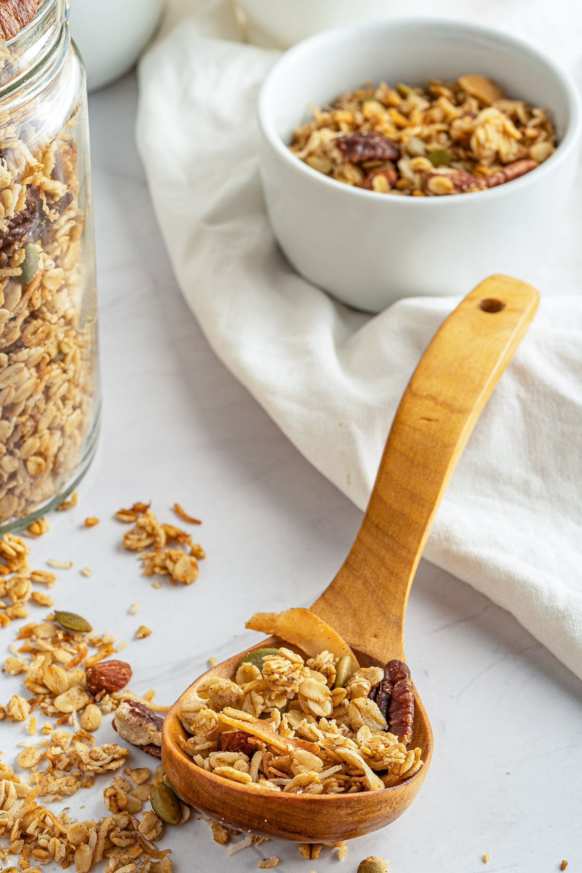 homemade granola with large spoon