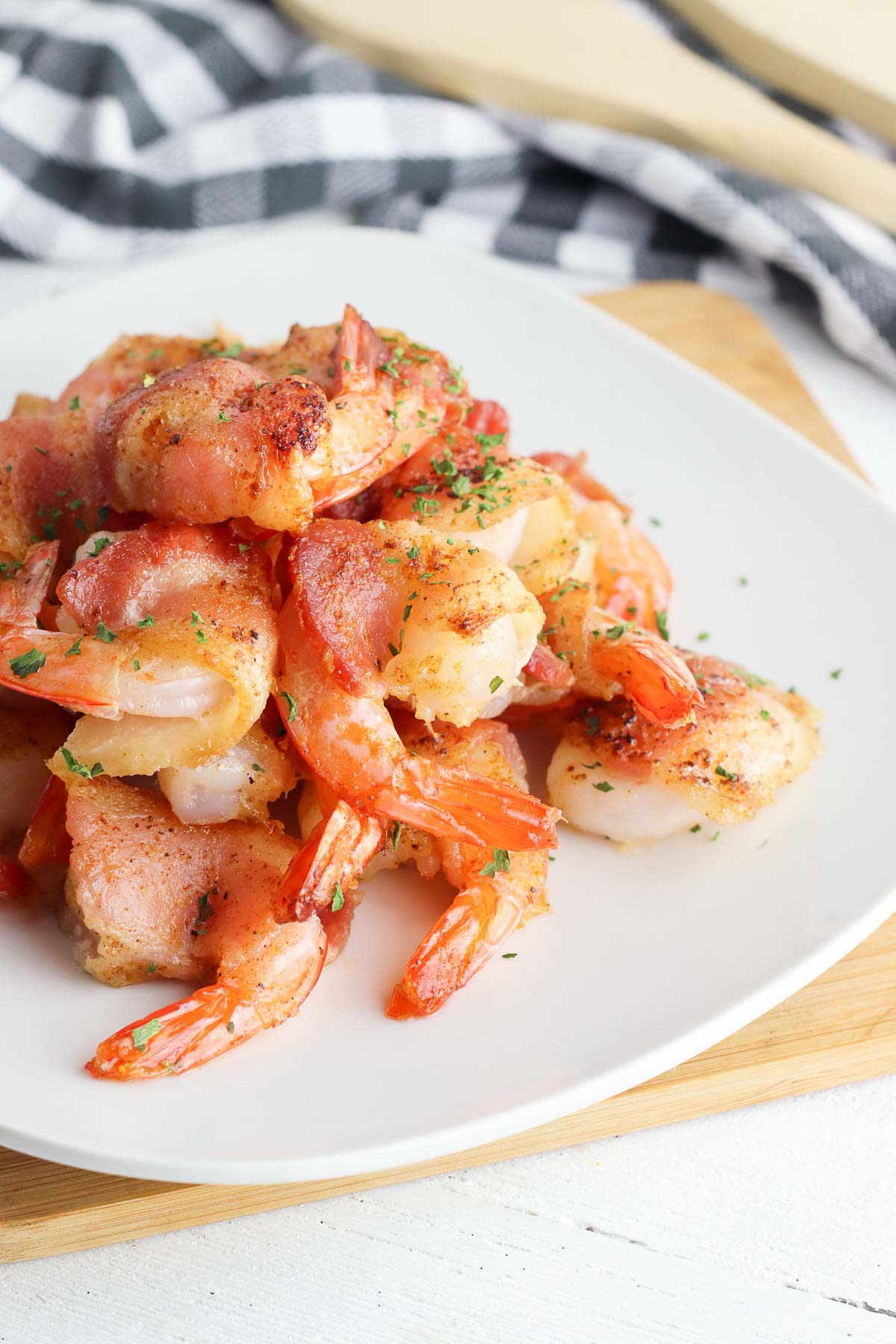 bacon wrapped shrimp on a white side