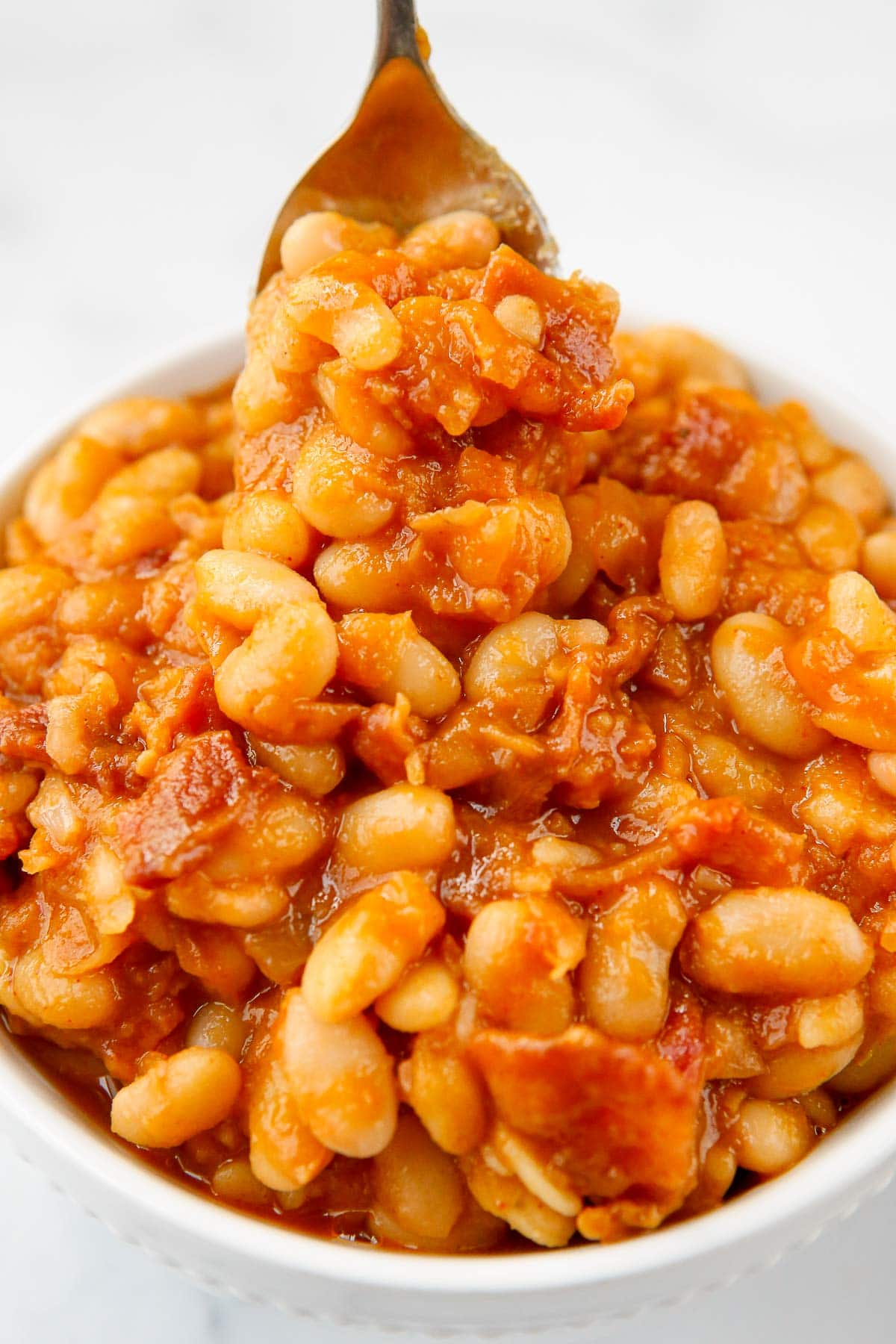 baked beans close up on spoon
