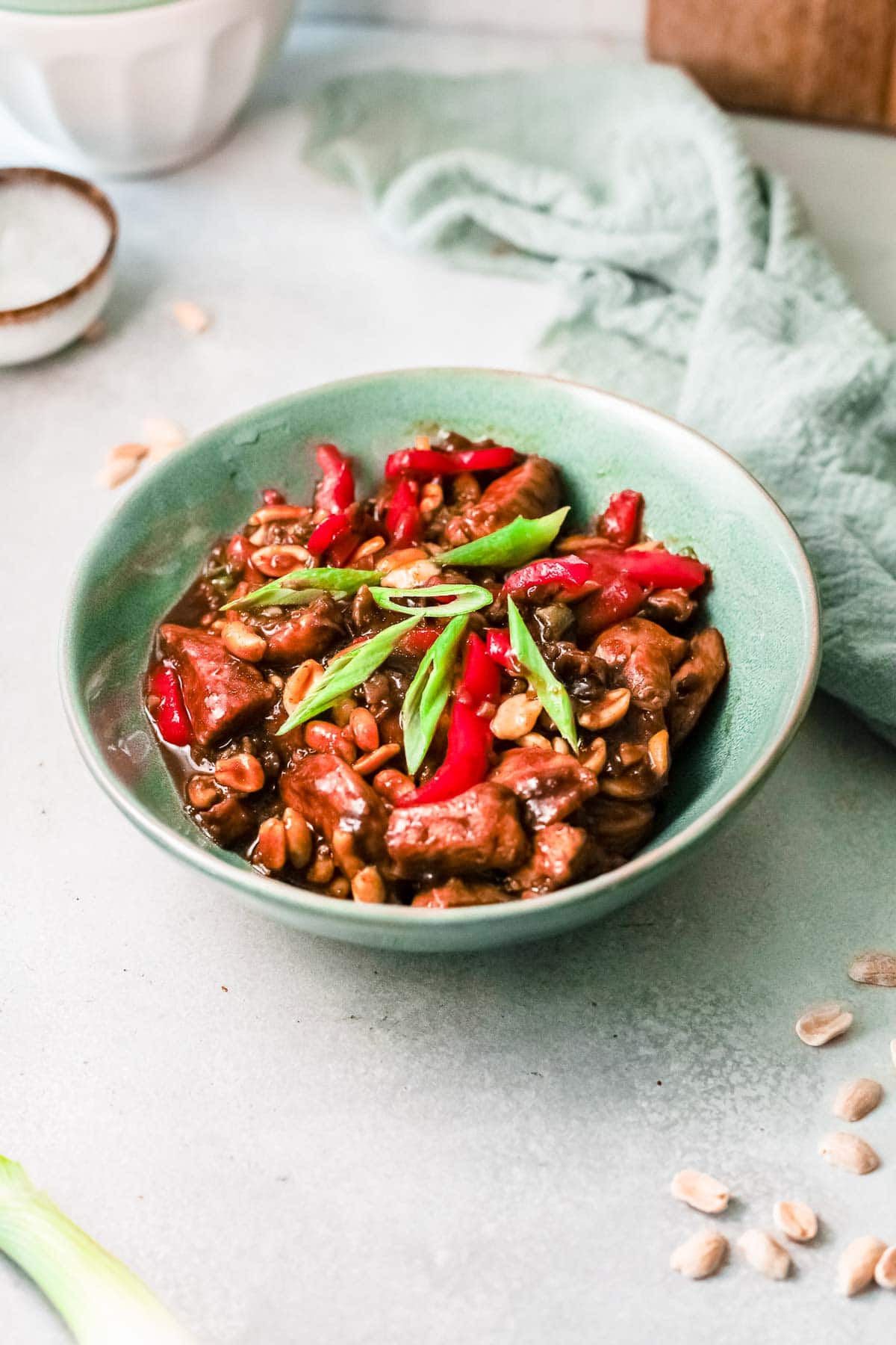 kung pao chicken in green bowl