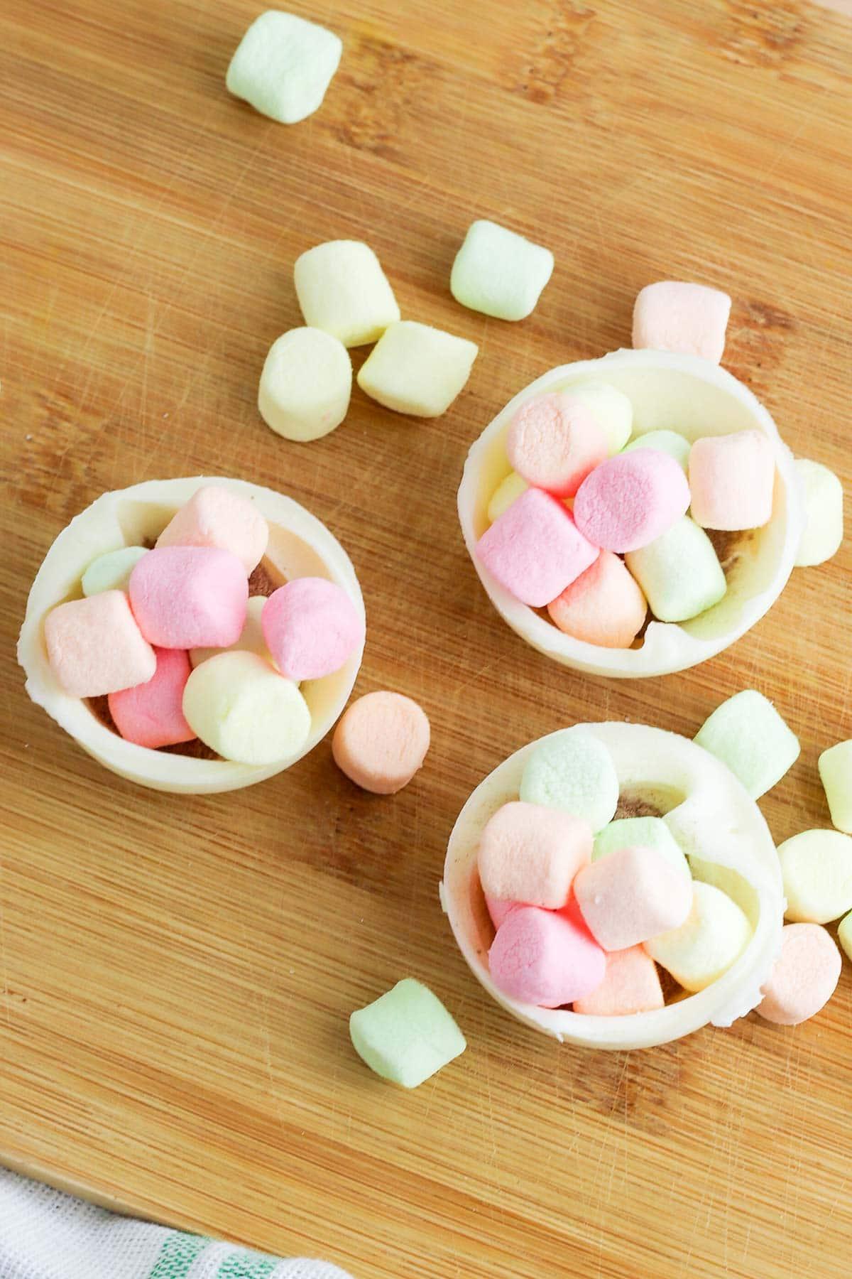 rainbow sprinkle white chocolate hot cocoa bombs marshmallows