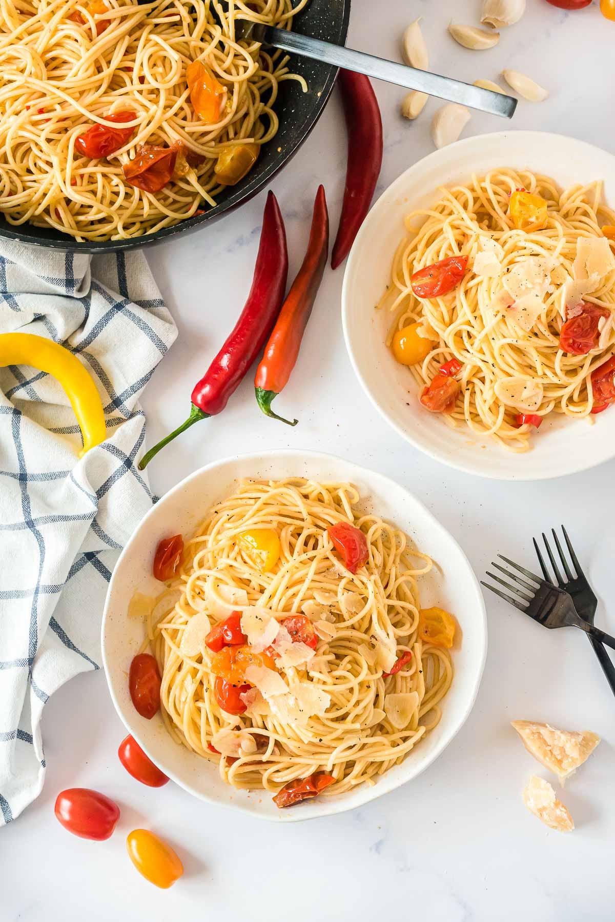 two bowls of spaghetti aglio e olio