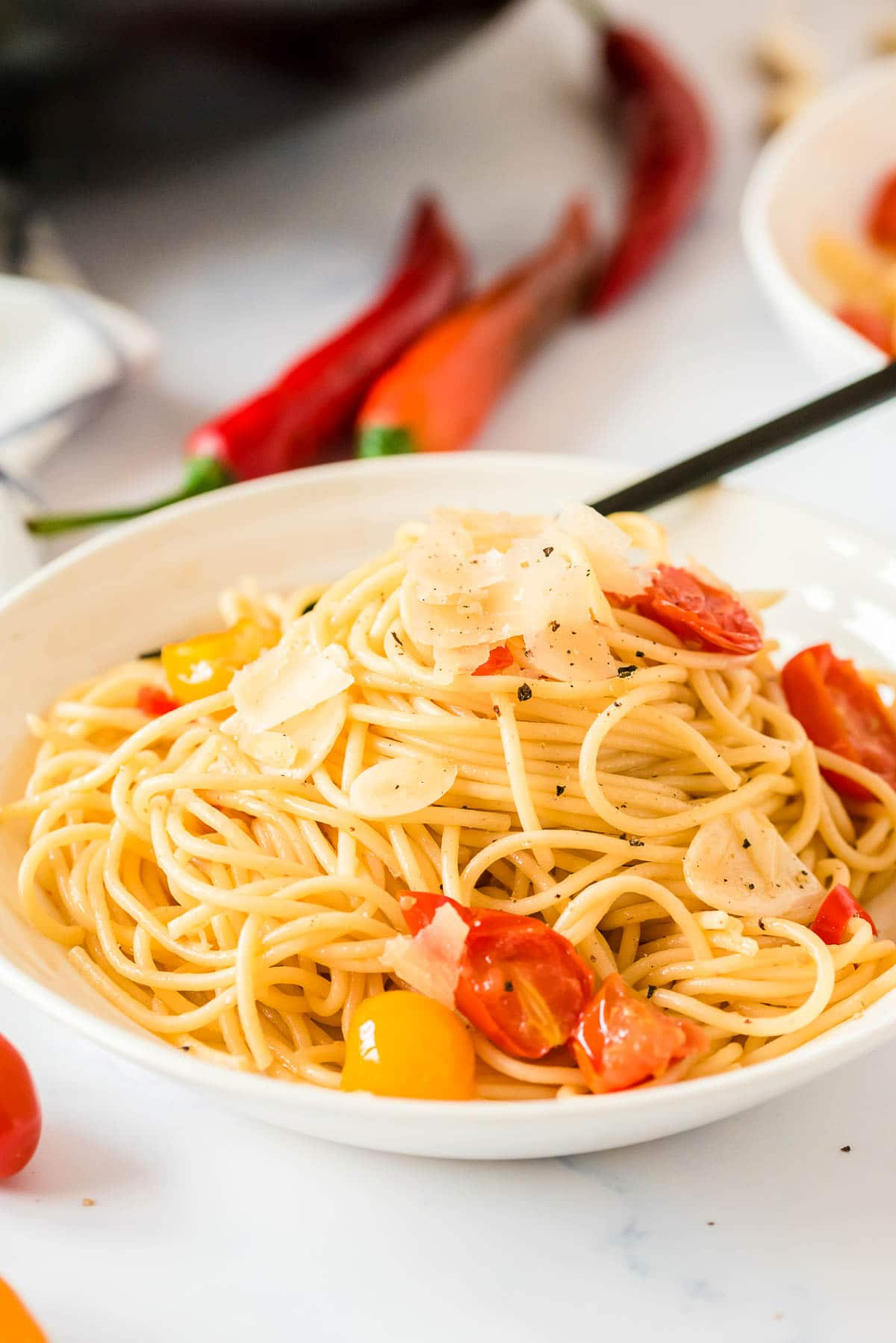 bowl of spaghetti aglio e olio side view