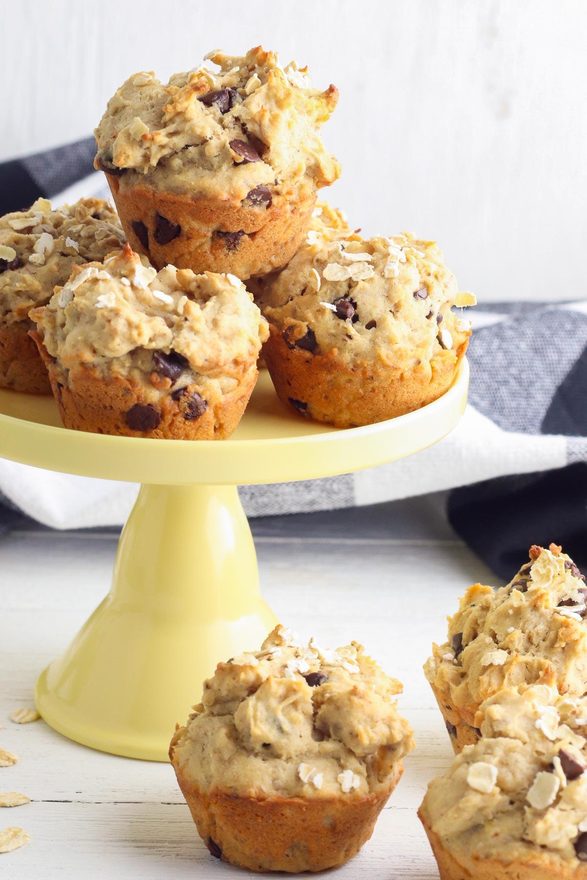 peanut butter banana muffins on pedestal