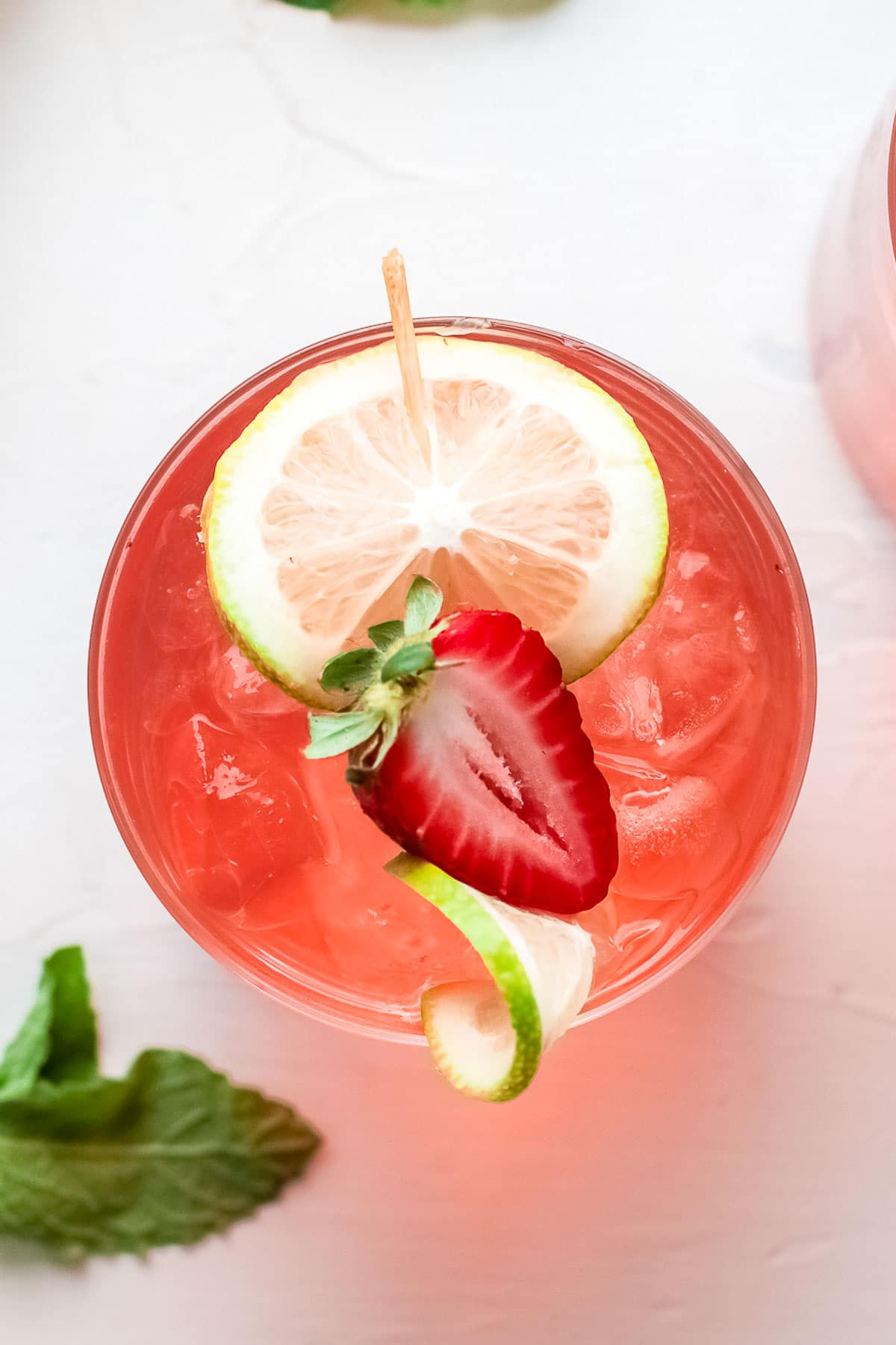 gin rickey with strawberry overhead