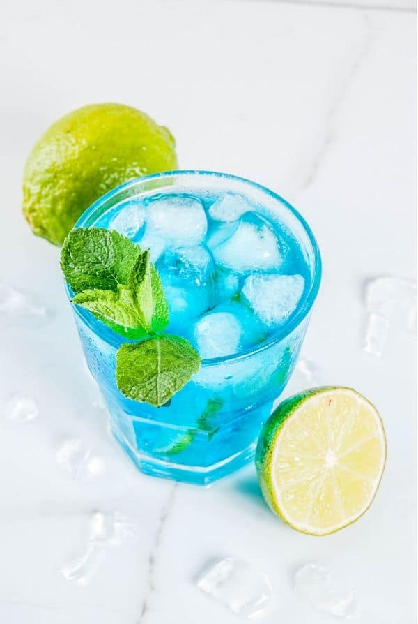 Blue Margarita with lots of ice and lime wedges