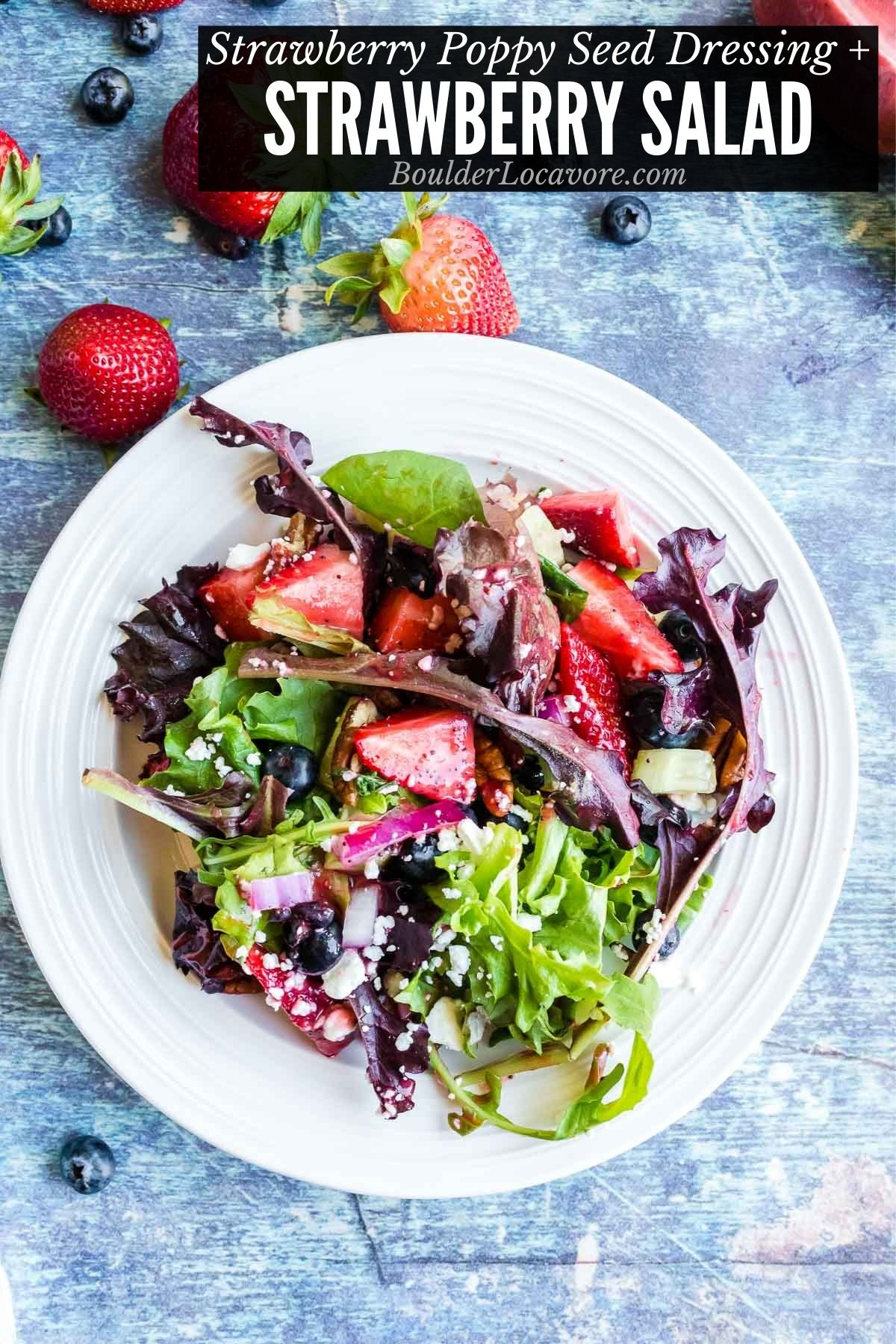 Strawberry Salad with Strawberry Poppy Seed Dressing on a white plate with recipe title