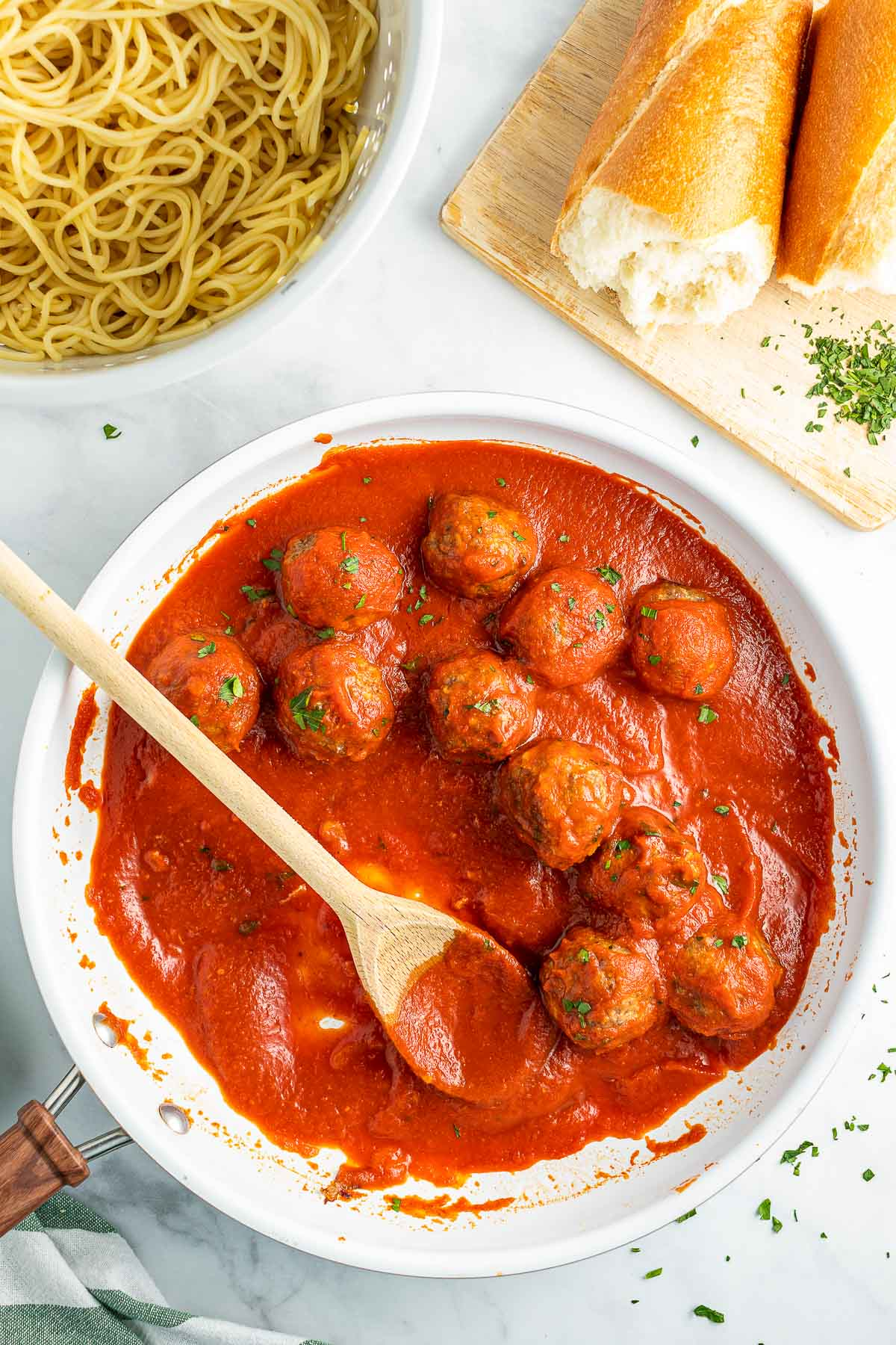baked Italian Meatballs in skillet with spoon