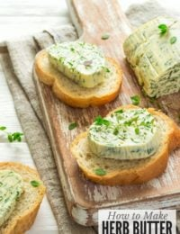 slices of bread with herb butter on cutting board
