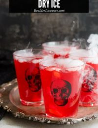 Glasses of punch with dry ice on tray (title image)
